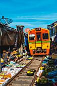 Maeklong Railway Market, Samut Songkhram, Bangkok, Thailand.