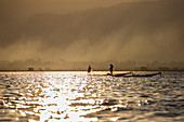 Fishing at sunset in Inle Lake, Shan State, Myanmar, Southeast Asia