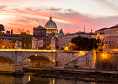 Rome at sunset with view of the dome of Saint Peter's Basilica, Octagonal Tower of the church of the holy spirit in the saxon district and Tiber River Europe, Italy, Lazio, Province of Rome, Rome, sunset