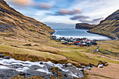 The cove of Tjornuvik and in background near the cliff the two sea stacks of Risin and Kellingin (Streymoy island, Faroe Islands, Denmark)