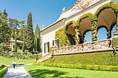 Woman walking in the gardens of Villa del Balbianello on Punta di Lavedo, Lenno, Como province, Lombardy, italy