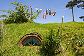 Clothes hanging on the washing line on top of a Hobbot house. Hobbiton Movie Set, Matamata, Waikato region, North Island, New Zealand.