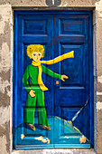 Painted doors in Santa Maria street for the Art of Open Doors project. Funchal, Madeira region, Portugal.