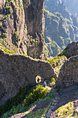 Two people descenging the steps on the trail from Pico Ruivo to Pico do Areeiro. Funchal, Madeira region, Portugal.