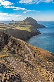 Woman walking on the trail to Point of Saint Lawrence. Canical, Machico district, Madeira region, Portugal.