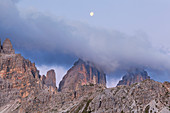 Cloudy dawn on Tre Cime di Lavaredo, Dolomites, Dobbiaco, South Tyrol, Bolzano, Italy