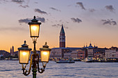 St. Mark's Campanile and Doge's Palace at sunset from Riva San Biasio at dusk, Venice, Veneto, Italy.