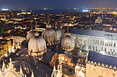 The domes of St. Mark's Basilica seen from the top of St. Mark's Campanile by night, Venice, Veneto, Italy.