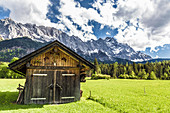 View from a hut on the alps edge on the Zugspitze, Garmisch-Partenkirchen, Bavaria, Germany