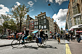 City life with cyclists in the center of Amsterdam, Netherlands