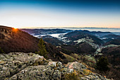 Valleys with morning fog in autumn and sunrise, view from Belchen, Neuenweg, Black Forest, Baden-Wurttemberg, Germany