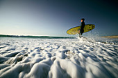 Young surfer in the surf, French Atlantic coast, Aquitaine, France