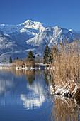 Winter Eichsee in front of Herzogstand and Heimgarten, Großweil, Werdenfelser Land, Upper Bavaria, Bavaria, Germany
