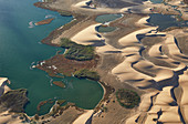 Walvis Bay lagoon and Namib desert dunes from the air, Namibia