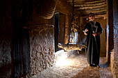 Old blind man, Berber, leads through a traditional Berber house, Valley of the Ammeln in Anti Atlas, Morocco