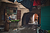 Fishmonger in the old town of Marrakech with archway and bearded customer, Morocco, Africa