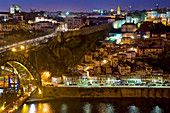 View over the Ponte Dom Luis I to the Cais da Ribeira with nested houses on the steep slope and the fortress wall, Porto, Portugal