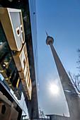 Berlin lettering on Alexanderplatz, Alex TV tower in backlight