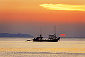 Sunset at Buffalo Bay, fishing boat, Koh Phayam, Thailand