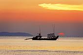 Sunset at Buffalo Bay, fishing boat, Koh Phayam, Thailand