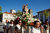 Men carry a statue of the Virgin in front of the cathedral in Lamego at the Douro, northern Portugal, Portugal