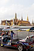 Tuk Tuk with royal palace in the background, Bangkok, Thailand