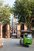 Tuk Tuk in the Historical Park of Sukhothai in front of the temple Wat Si Sawai, ancient royal city, Sukhothai, Thailand