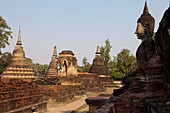 Buddha statue in the Historical Park of Sukhothai in the temple Wat Mahathat, ancient royal city, Sukhothai, Thailand