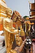 Buddha statue in Golden Buddhist Temple. Wat Prah That Doi Suthep, Chiang Mai, Thailand