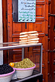 Food stand with olive bread in the medina and the souks of Marrakech, Marrakech, Morocco
