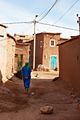 Bedouin in the alleys of the Kasbah Ait Ben Haddou and the desert, Ait Ben Haddou, Morocco