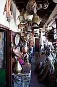 Souvenir shop with metal goods in the souks of the medina, Marrakech, Morocco