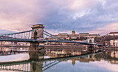 Chain bridge and castle palace in Budapest Hungary at sunrise