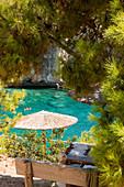 Bathing fun in the bay of Porto Limnionas, Zakynthos, Ionian Islands, Greece