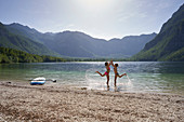 2 girls are clapping, SUP, Bohinj Lake, Triglav National Park, Slovenia