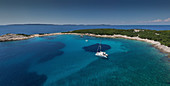 Catamaran at anchor Bay of Tomozina, Cres, Croatia