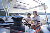 2 girls at the helm, catamaran EOS off the west coast of Cres, Kvarner bay, Croatia