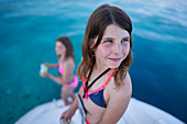 2 girls on the bathing platform of a sailing yacht, Bay of Tomozina, Cres, Croatia