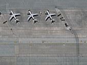 Aerial view airplanes parked on tarmac at airport