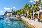 View of boats and old town restaurants in Cavtat on the Adriatic Sea, Cavtat, Dubrovnik Riviera, Croatia, Europe