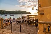 View of restaurant at sunset in Cavtat on the Adriatic Sea, Cavtat, Dubrovnik Riviera, Croatia, Europe