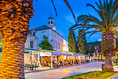 View of restaurants and church at dusk, Cavtat on the Adriatic Sea, Cavtat, Dubrovnik Riviera, Croatia, Europe