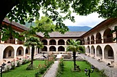 Courtyard with arcades and palms of caravansary in Sheki, Azerbaijan, Asia