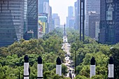 Street canyon and monument among skyscrapers, view from Chapultepec on the Paseo Reforma, Mexico City, Mexico