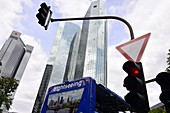 both buildings of Deutsche Bank in the financial district and sightseeing bus with traffic lights, Frankfurt, Hesse, Germany