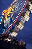 Ferris wheel Oktoberfest at the blue hour, Munich, Germany
