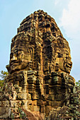Tower with two of the 216 smiling sandstone faces at 12th century Bayon temple in Angkor Thom walled city, Angkor, UNESCO World Heritage Site, Siem Reap, Cambodia, Indochina, Southeast Asia, Asia