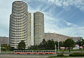 Tower blocks of flats beside urban tram, in centre of Pyongyang, North Korea, Asia