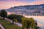 View of floating bars and nightclubs on Sava River across to Victor Monument at Belgrade Fortress, Belgrade, Serbia, Europe