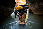 A woman explores the Narrows in Zion National Park, Utah.
